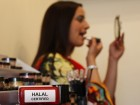 A stamp lies on a table as Sabah Zaib applies Halal certified make-up in Birmingham